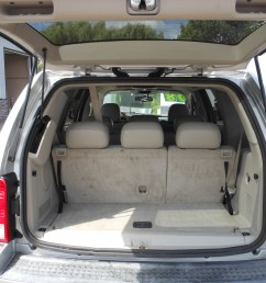 sun roof power driver and passenger seats 3rd row seating back up camera power windows locks and mirrors am fm cd mp3 aux roof rack chrome wheels [ 4608 x 3456 Pixel ]