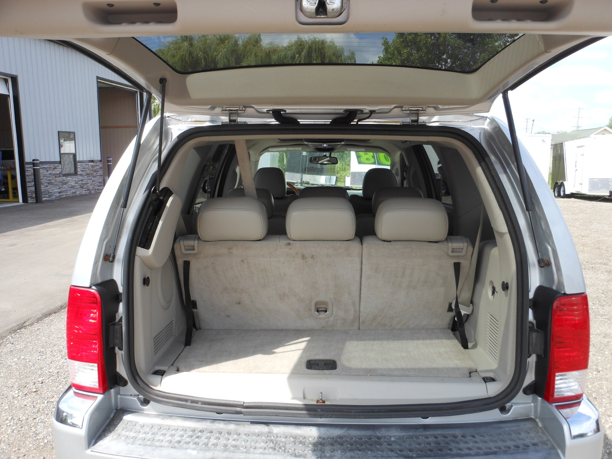 hight resolution of  sun roof power driver and passenger seats 3rd row seating back up camera power windows locks and mirrors am fm cd mp3 aux roof rack chrome wheels