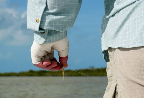 Angler holds fly, #3,247.  Photo: Gary Thompson