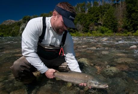 Happy angler, hefty fish.