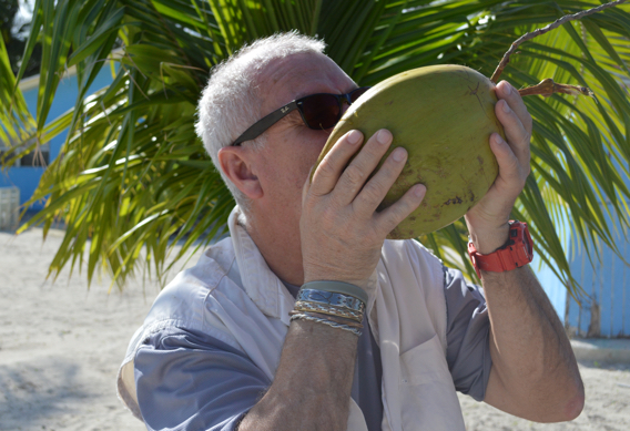 Drinking coconut water in the Bahamas.