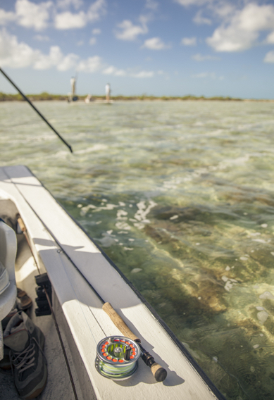 Fly fishing for bonefish from a flats skiff.