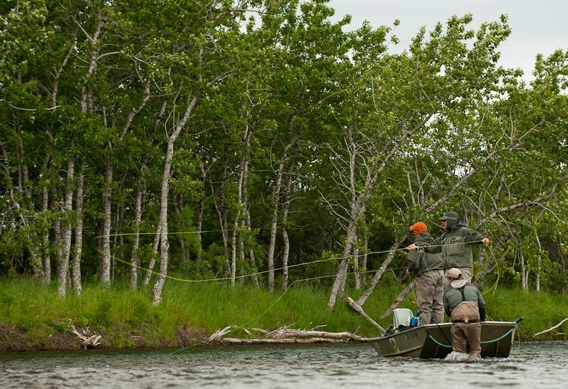 Fly fishing for trout from a boat by Cameron Miller.