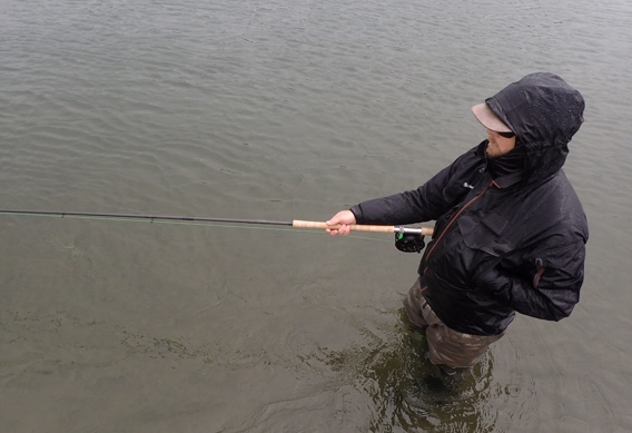Holding the rod while swinging flies with a spey rod.