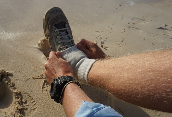 Keeping sand out of wading boots.
