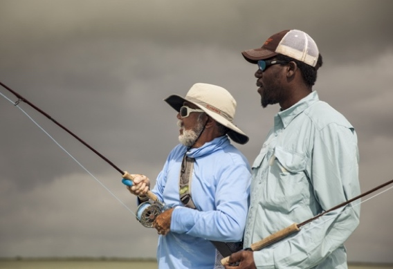 Fighting bonefish at Andros South by Hollis Bennett.