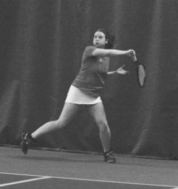 Taylor Hawkins '16 takes a swing during the tennis match.