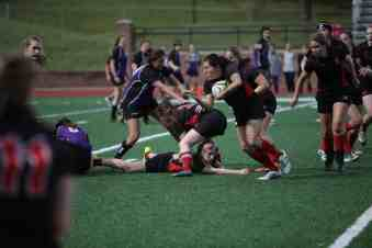 Jen Vo '16 picks up the ball with a parade of help from behind. Vo had two tries in the 50-0 win.