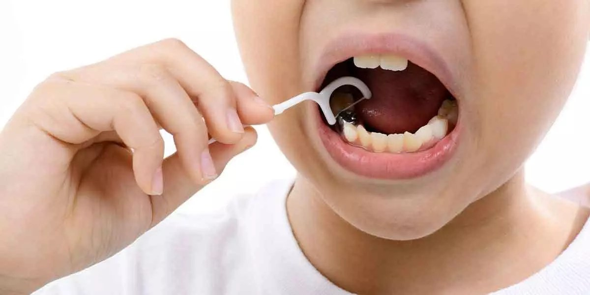 Kids Teeth Flossing