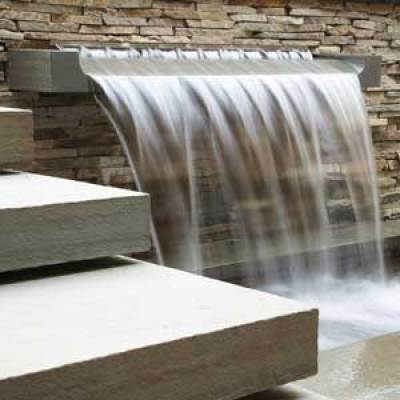Custom water features add depth and beauty to your poolside area