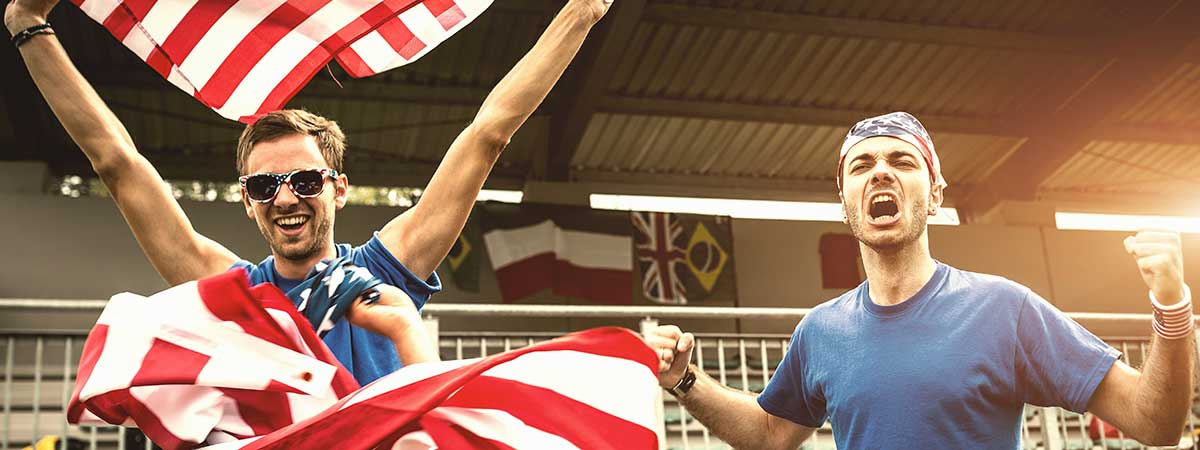 Americans at game with flag