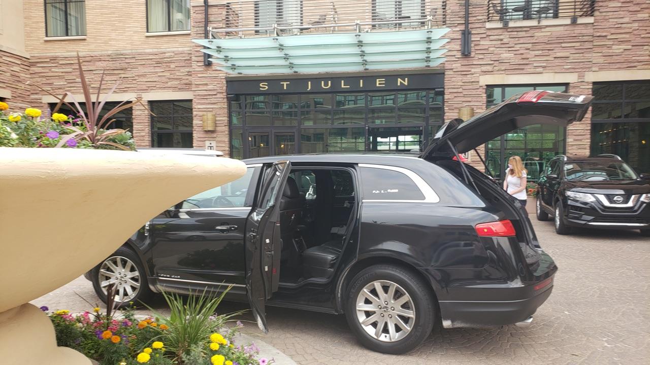 black car at St Julien Hotel waiting for customer