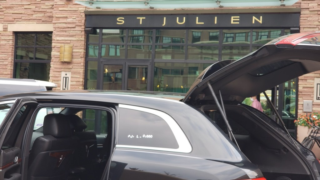 St Julien Hotel Black car waiting for a ride to Denver Airport