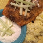 Alaska Broiled salmon with Spanish saffron rice and cucumber cumin raita sauce: