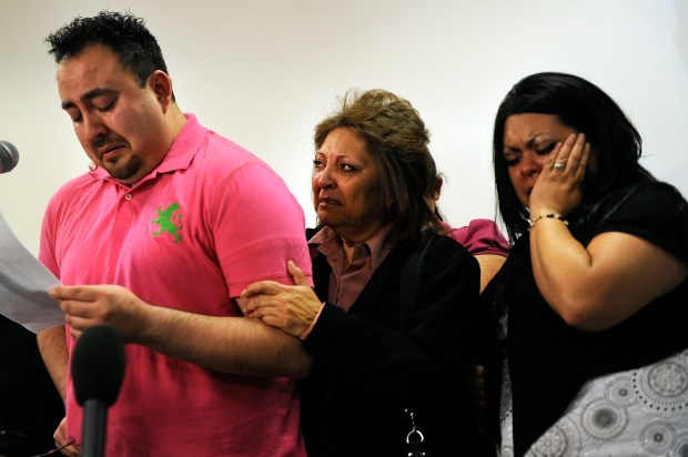 Gonzo Zapata, along with his mother Maria and sister Monica, breaks down while reading a statement on April 22, 2009, after the sentencing of Allen Andrade, who was convicted of killing his sister, Angie Zapata, a transgendered woman.