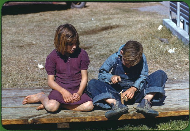 Boy building a model airplane as girl watches. Robstown, Texas, January 1942. Reproduction from color slide. Prints and Photographs Division, Library of Congress