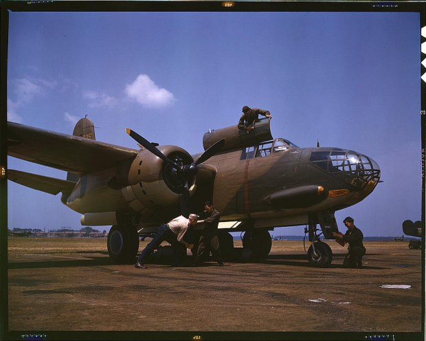 Servicing an A-20 bomber. Langley Field, Virginia, July 1942. Reproduction from color slide. Prints and Photographs Division, Library of Congress
