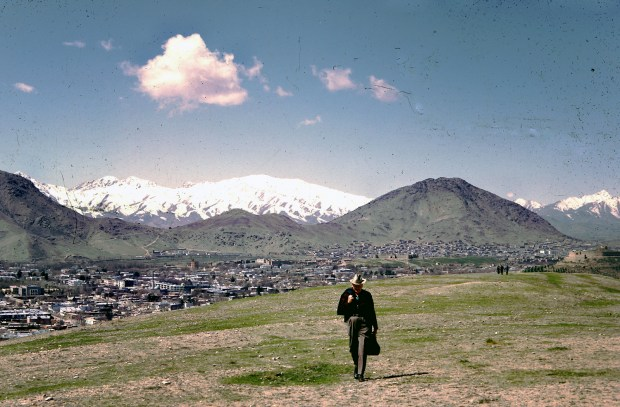 """Dr. Bill Podlich on a hillside in Kabul. """"My dad was a professor of Elementary Education, specializing in teaching Social Studies, at Arizona State University in Tempe, Arizona from 1949 until he retired in 1981. He had always said that since he had served in WWII (he trained soldiers against chemical warfare), he wanted to serve in the cause of peace. In 1967, he was hired by UNESCO as an Expert on Principles of Education, for a two-year stint in Kabul, Afghanistan at the Higher Teachers College. Throughout his adult life, because he was interested in social studies, whenever he traveled around (in Arizona, to Mexico and other places), he continued to take pictures. In Afghanistan he took half-frame color slides (on Kodachrome), and I believe he used a small Olympus camera."""" - Peg Podlich."""