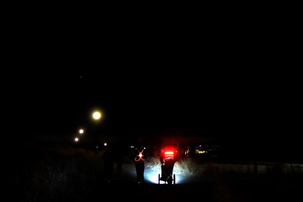 DENVER, CO - MARCH 08: Jason Romero uses a headlamp and a stroller with headlights to add contrast to to the roadway on a pre-dawn run with his coach Carly Gerhart, friend Joanna Oomkes and her dog, Moab at Central Park in the Stapleton neighborhood of Denver. Due to his retinitis pigmentosa, Romero suffers from night blindness and relies on his headlamp and reflectors when running to give him site of contrast. Romero describes seeing as looking through a tube with site of only color and contrast and no detail beyond a matter of inches. Romero has a 15-degree field of vision and 20/200-400 site depending on available light. (Photo by AAron Ontiveroz/The Denver Post)
