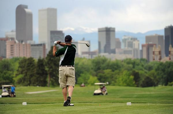 Golfer Dane Jessen of Denver follows his shot after teeing off of Hole 8 at Denver's City Park Golf Course. Golfers took advantage of the beautiful weather to play some rounds of golf on May 16, 2012.