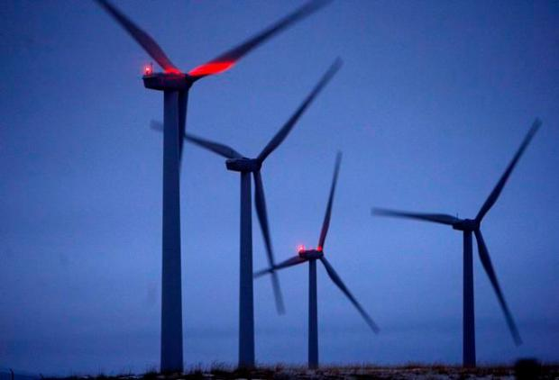Turbines spin in a soft breeze near Casper, Wyoming in this January, 2011 file photo.