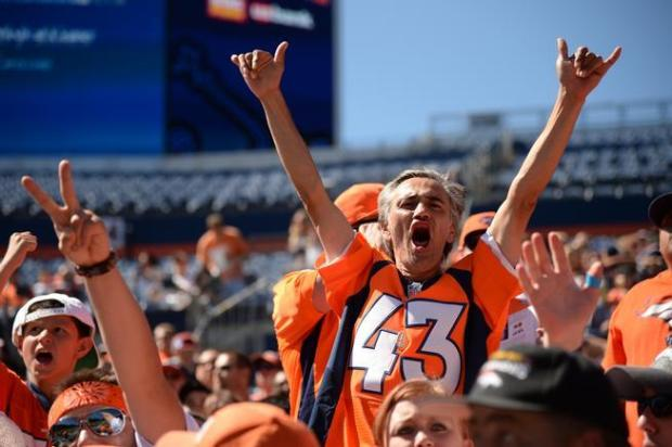 Denver Broncos fans welcome the players at Sports Authority Field at Mile High.