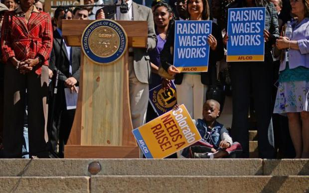 Supporters of raising Colorado's minimum wage rally at the Capitol in Denver on March 23. (RJ Sangosti, The Denver Post)