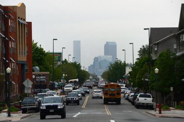 DENVER, CO - MAY 21: The skyline of Denver can be seen along Morrison Road in the Westwoo dneighborhood of Denver , Colorado on May 21, 2015. Home prices and rents in southwest Denver, in neighborhoods such as Westwood, are skyrocketing taking out one of the last truly affordable pockets in Denver.
