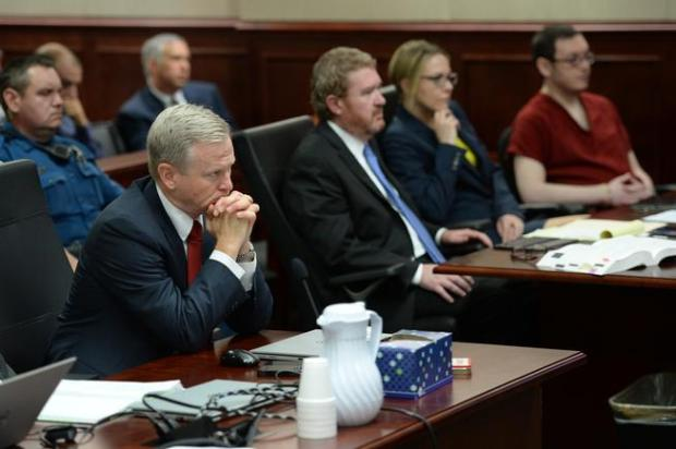 District Attorney George Brauchler, left, in court as death penalty defendant James Holmes appears before the judge to be formally sentenced, August 26, 2015.