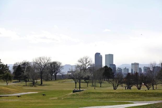 The downtown Denver skyline seen from City Park Golf Course in Denver.