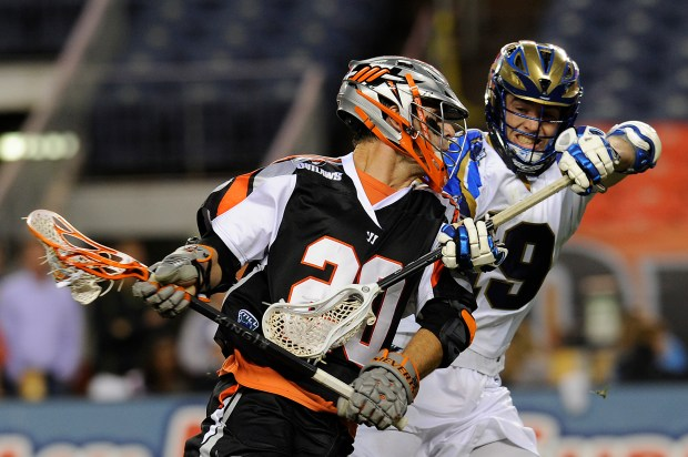 In this file photo, Jeremy Sieverts (20) of the Denver Outlaws is pressured by Kevin Drew (19) of the Charlotte Hounds during the second half at Sports Authority Field at Mile High in Denver, May 30, 2014.