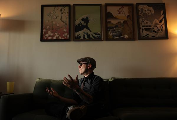 "Jason Heller, seen here in his high-rise Capitol Hill apartment, has worked as a cartoonist, DJ, musician and editor. Quirk Books is releasing his first novel, ""Taft 2012,"" this month."
