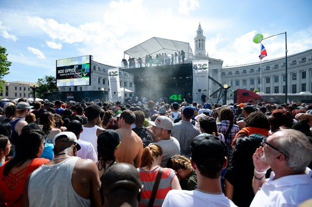 Festival-goers pile in front of the main stage waiting eagerly for 4:20 p.m. and Wiz Khalifa to perform during the Denver 4/20 Rally in Civic Center park, held on May 21. 2016, after it was postponed by snow a month earlier.