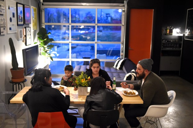 DENVER, CO - FEBRUARY 29: Josh and Tran Wills eat dinner with three of their four children, Ellie, Quynh and Hesh, on Monday, February 29, 2016. The Wills family is among the first moving into Freight Residences, a family-oriented apartment community in the Taxi development in RiNo.(Photo by AAron Ontiveroz/The Denver Post)