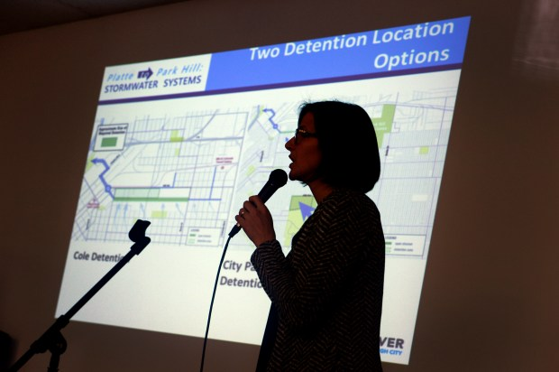 Meredith Wenskoski, a landscape architect at Design Workshop, shows the designs for Denver's proposed flood-control projects at an April 6 meeting.