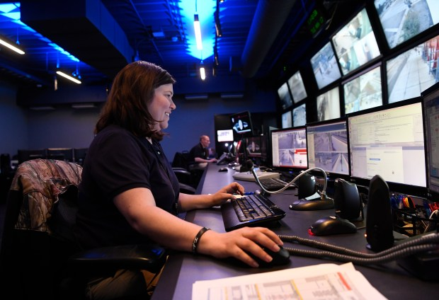 Public safety dispatcher Ragan Young keeps her eyes on monitors at the RTD Transit Security Command Center May 17, 2016.