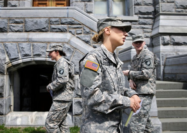 In this April 9, 2014 photo, West Point cadet Austen Boroff, center, of Chatham, N.J., gathers with others as she waits to march to lunch at the United States Military Academy in West Point, N.Y.