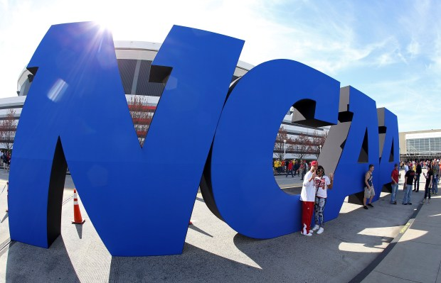 A NCAA logo is seen outside the Georgia Dome before a 2013 men's Final Four game.