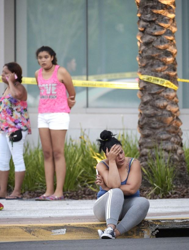 People wait outside emergency room