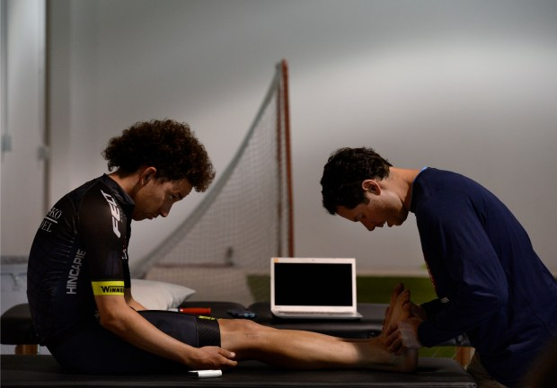 BOULDER, CO - JUNE 13: Dr. Matthew Smith, right, of Revo Physiotherapy & Sports Performance, works with pro cyclist Joe Lewis. Businesses at Black Lab Sports, an accelerator in Boulder, spend time in their open spaces at the industrial offices on Monday, June 14, 2016. (Photo by Kathryn Scott Osler/The Denver Post)