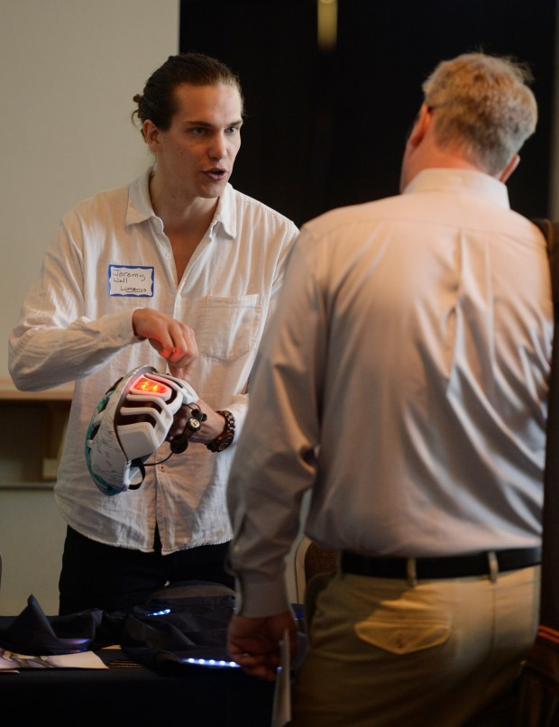 DENVER, CO - JUNE 15: Sports Authority Field at Mile High was the site of the Global Sports Innovation Competition on Wednesday, June 15, 2016. Black Lab Sports hosted the ten entrepreneurs who were competing to go to Rio. Entrepreneur Jeremy Wall shows off the lights on a helmet and fitness clothing for his company Lumenus from Los Angeles. (Photo by Cyrus McCrimmon/The Denver Post)