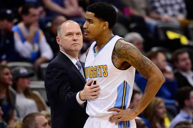 DENVER, CO - JANUARY 21: Denver Nuggets head coach Michael Malone pats guard Gary Harris (14) on the stomach after he got hit with his second foul during the first quarter at the Pepsi Center on January 21, 2016 in Denver, Colorado. (Photo by Brent Lewis/The Denver Post)