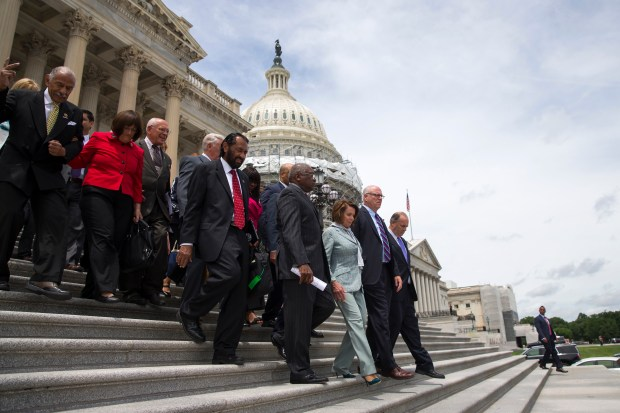House Minority Leader Rep. Nancy Pelosi of Calif. leads House Democrats down the steps of the Capitol building in Washington, Thursday, June 23, 2016, after ending their sit-in protest. (AP Photo/Evan Vucci)
