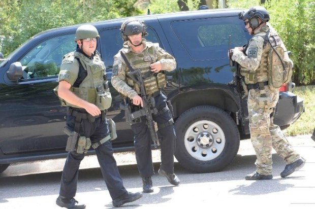 SWAT officers respond to a reported burglary in Lafayette this morning. (Paul Aiken / Staff Photographer )
