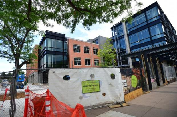 A construction worker passes by PearlWest, which has 160,000 square feet of office and retail space, in downtown Boulder. For more photos, go to dailycamera.com.  Autumn Parry, The Daily Camera