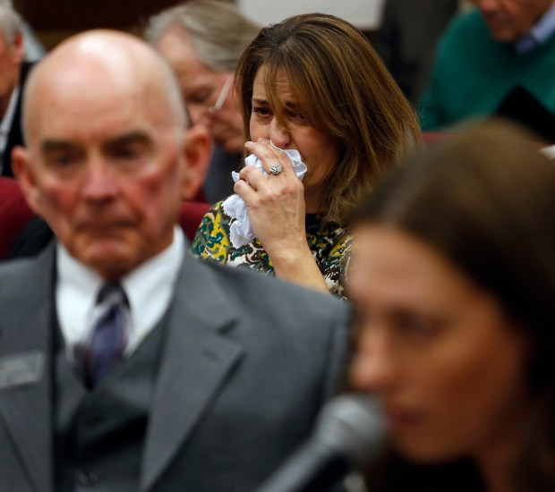 Tara Allgood, center, who lost her father to a brain tumor, cries as she listens to testimony in favor of legislature that would provide end-of-life options for terminally ill individuals, during a hearing at the state Capitol on Feb. 3. The bill failed, but the issue is now on the Colorado ballot as an initiative.