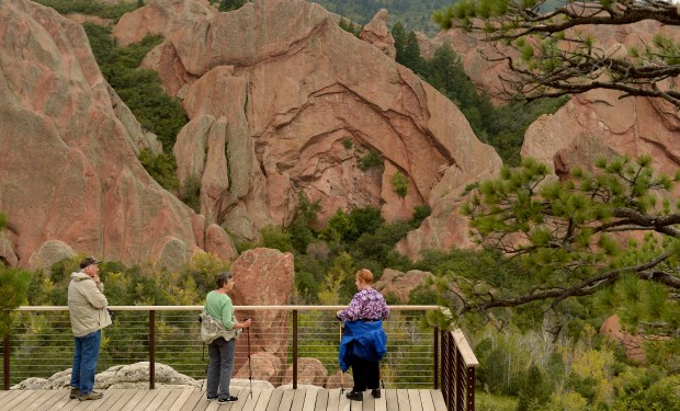 ROXBOROUGH, CO. SEPTEMBER 29: Roxborough State Park is in the south metro area. Hikers left to right: Jack Davison, his wife Nancy Davison, and Jack's sister Lee Cook look out over the massive rock formations from the Lyons Overlook while doing the Fountain Valley Trail in the park on Monday, September 29, 2014. (Denver Post Photo by Cyrus McCrimmon)