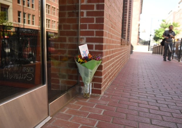 DENVER, CO - JUNE 29: Flowers were left outside the doors at The Alliance Center after a shooting on Tuesday afternoon, June 29, 2016. (Photo by RJ Sangosti/The Denver Post)