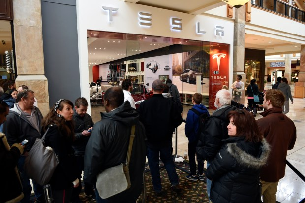 CENTENNIAL, CO - MARCH 31: Tesla fans stand in line at Park Meadows March 31, 2016 to preorder the new Tesla due to be unveiled Thursday night. Some Tesla fans showed up as early as Wednesday night to be the first in line and the line slowly grew between 400-500 people. Tesla CEO Elon Musk is due to unveil its Model 3, its first mass-market car, at an evening event in the suburb of Hawthorne. At an expected price tag of about $35,000, it's still going to come in closer to compete more directly with Acura, BMW, Mercedes-Benz and other popular luxury brands in the market today. (Photo By John Leyba/The Denver Post)