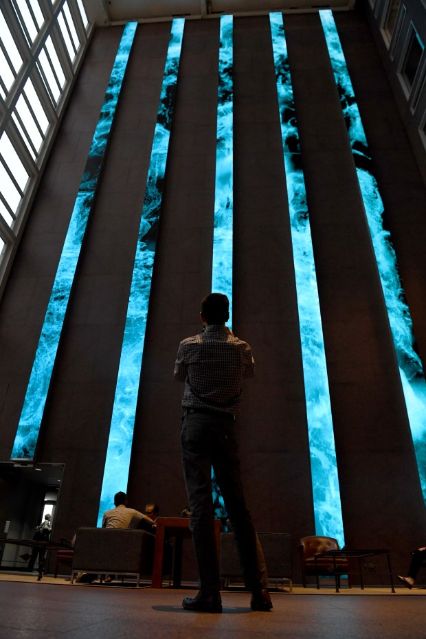 Michael Chavez makes a video of the nearly eight-story digital art installation in the atrium of Denver's Wells Fargo Center, which uses both photo and video to showcase a mosaic — made up of thousands of Instagramphotos — of Colorado mountainscapes and a floor-to-ceiling 3-D waterfall, among other offerings.